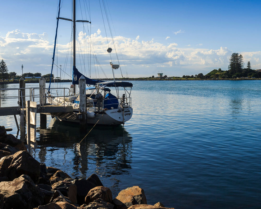 Boat moored at jetty on Tuncurry river