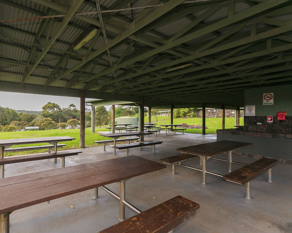 Undercover BBQ seating area at Killalea camping ground
