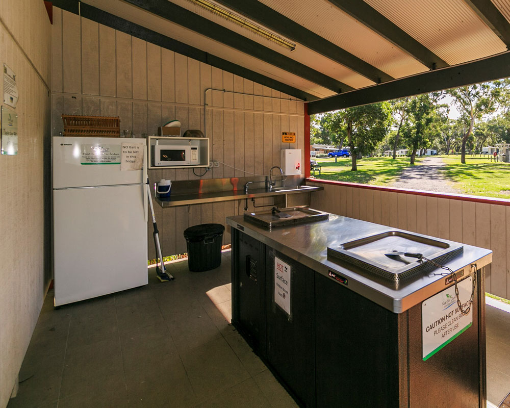 Cooking facilities in camp kitchen at Jimmys Beach caravan park